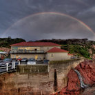 Picture - Rainbow over the wharf at Merimbula.