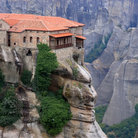Picture - One of the monasteries of Meteora sits high on the rocky cliffs.
