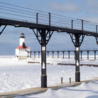 Picture - The waterfront and lighthouse at Michigan City in in winter.