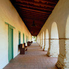Picture - Arches along the main walkway of the San Juan Bautista Mission.