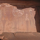 Picture - Native American art on a rock wall near Moab.