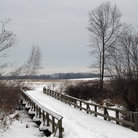 Picture - Snow covered wooden bridge and field in Monmouth Battlefield State Park, New Jersey.