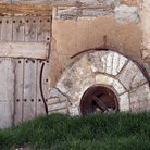 Picture - Old mill´s door and stone wheel in Monreal del Campo.