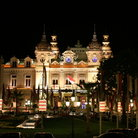Picture - A building lit up at night in Monte Carlo.