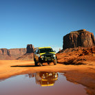 Picture - Driving down a dirt road in Monument Valley.