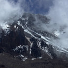 Picture - Clouds over the peak of Mt Kilimanjaro in Tanzania.