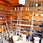 Picture - Mount Locust interior with various tools & kitchen implements on Natchez Parkway.