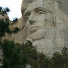 Picture - Lincoln's face on Mount Rushmore.