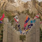 Picture - Aisle of state flags leading to Mount Rushmore.