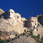 Picture - Washington, Jefferson, Teddy Roosevelt and Lincoln carved on Mount Rushmore.
