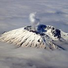Picture - Smoking summit of Mount St Helens National Volcanic Monument.