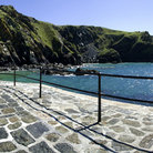 Picture - Walkway along the waterfront at Mullion Cove.