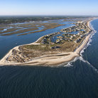 Picture - An aerial view of a beach lined peninsula in Murrells Inlet.