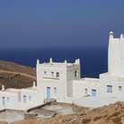Picture - Houses and the barren countryside of Mykonos.