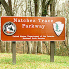 Picture - Sign & forest of Natchez Trace Parkway.
