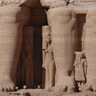 Picture - The Huge legs of pharaoh Ramses II in front of the Sun Temple of Abu Simbel.