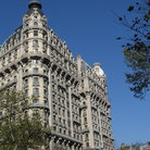 Picture - A blue sky over the Ansonia Hotel in New York City.