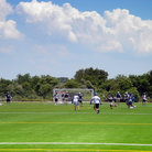 Picture - Lacrosse players in action on the Floyd Bennet field in Brooklyn, New York.