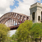 Picture - Summer view of the Hell Gate Bridge in New York.