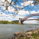 Picture - Distant view of the Hell Gate Bridge that links Queens to the Bronx in New York.