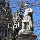 Picture - Verdi Square statue & apartment building at 74th Street in New York City.