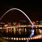 Picture - Night view of the Gateshead Millenium Bridge in Newcastle.
