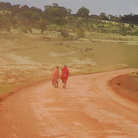 Picture - Masai on a dusty road of red earth in the Ngorongoro Conservation Area.
