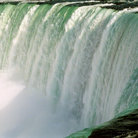 Picture - Water pouring over the lip of horseshoe falls at Niagara Falls.