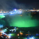 Picture - The glowing lights of Niagara Falls at night.