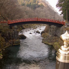 Picture - A sacred bridge over a river in Nikko National Park.