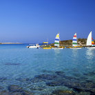 Picture - Sailboats in the clear waters off Nissi Beach.