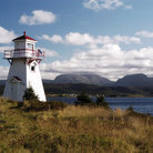 Picture - Woody Point Lighthouse and Bonne Bay with Gros Morne mountain in the distance.