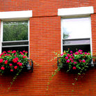 Picture - Fragment of a red brick house with wrought iron flower boxes in Boston's North End.