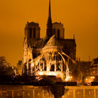 Picture - View of Notre Dame from the river at night in Paris.