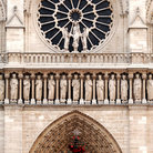 Picture - The rose windown above the west front entrance at Notre Dame in Paris.