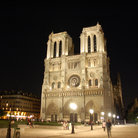 Picture - A night view of the west front of Notre Dame in Paris.