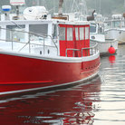 Picture - Red fishing boat in Perkins Cove near Ogunquit.