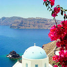 Picture - Steeple and flowers in Oia, Santorini (Thira) island.