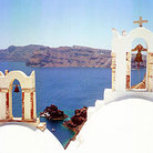 Picture - Steeples and bells looking towards Thirassia in Oia on Santorini (Thira).