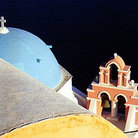 Picture - Steeple and deep blue water in Oia on Santorini (Thira).