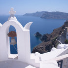 Picture - Church bell and view over cliffside in Oia.