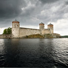 Picture - Dramatic sky over Olavinlinna Castle in Savonlinna.