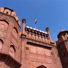 Picture - Turrets and flag of the Red Fort in Delhi.