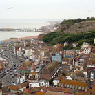 Picture - Hastings Old Town with the ocean in behind.
