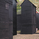 Picture - Traditional black huts in Old Town Hastings.