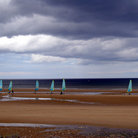 Picture - Wind surfers on Omaha Beach.