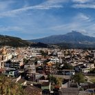 Picture - A panoramic view over Otavalo with mountains in behind.
