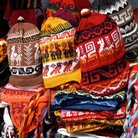 Picture - Hats for sale at a street market in Otavalo.