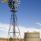 Picture - Windmill and water tank in the Outback.