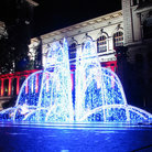 Picture - Fountain lit up at Palais de Rumine in Lausanne.